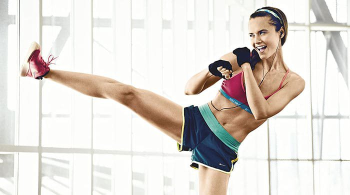 Woman firing up her willpower with a workout