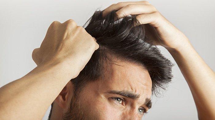 A man grooming his hair
