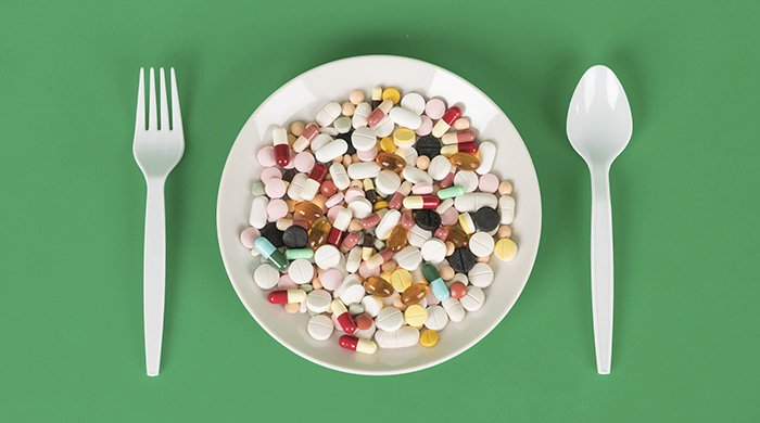 A plate full of pills to illustrate the diet pill scams on the internet