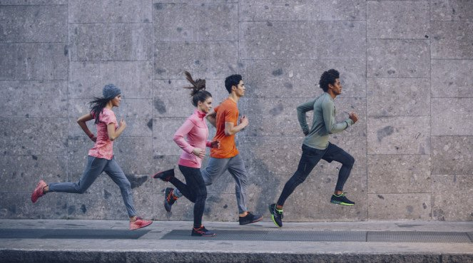 A group of people wearing Asics sneakers on a run