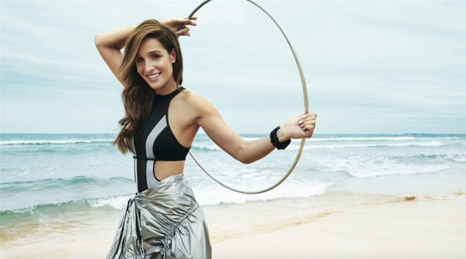Kayla Itsines on the beach looking total-body toned thanks to her workout