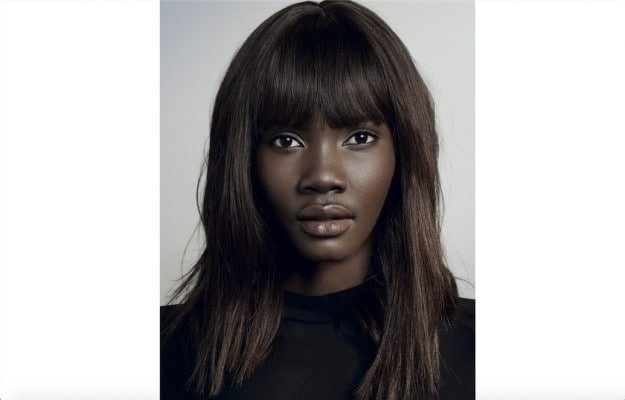 Woman with a fringed lob