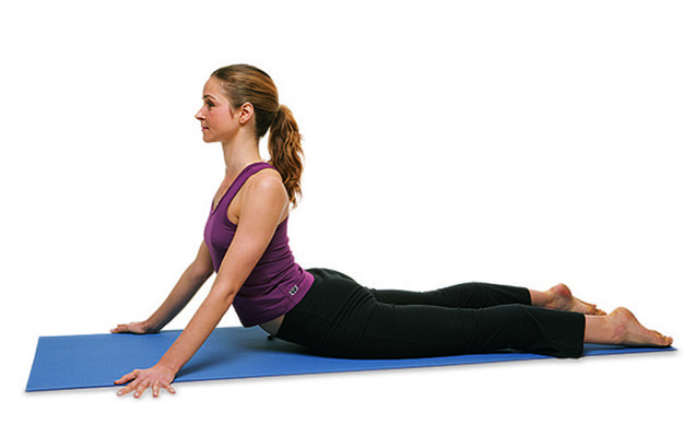 Woman doing the seal pose for back tension