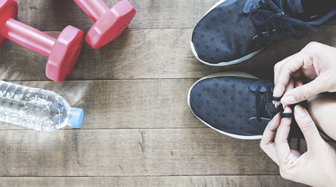 A woman spring cleaning her fitness gear