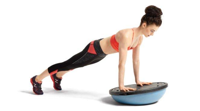 Woman doing a bosu push-up