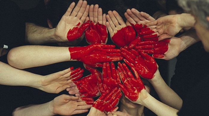 People making a heart with their hands