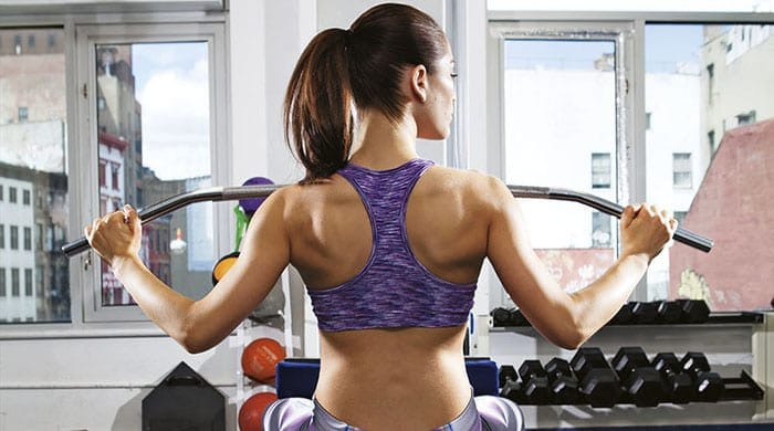 Woman weight-lifting at the gym