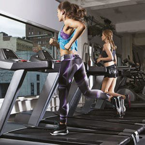 Woman doing a strength-training workout on a treadmill