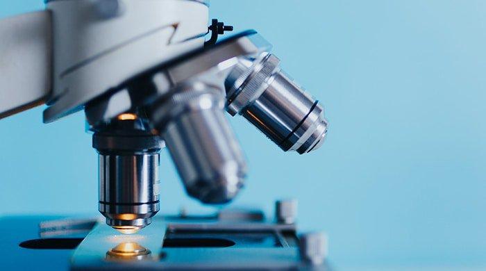 Microscope looking at motor neurone disease slides