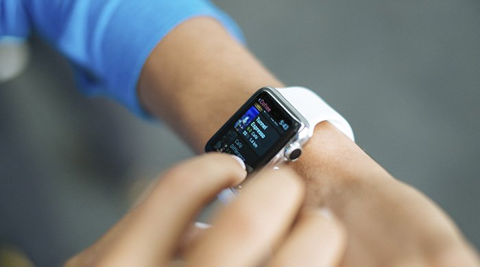 A woman using a fitness tracker as one of her dieting strategies