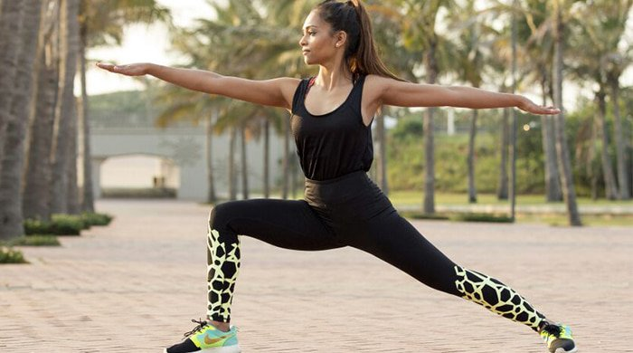 A woman stretching to prevent injuries before she runs