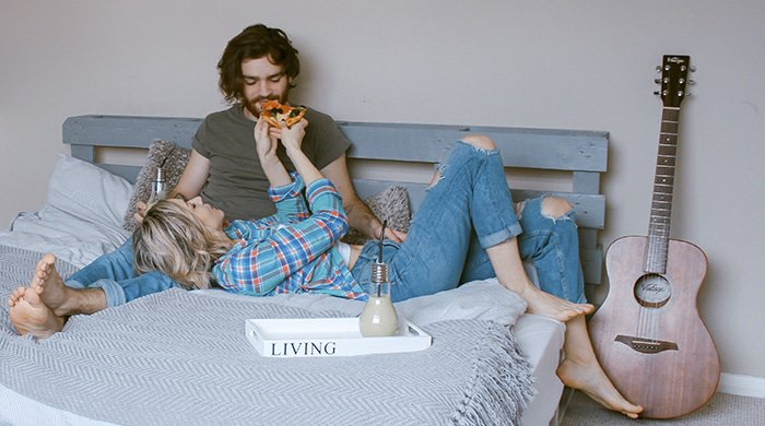 a woman lying on a bed with her boyfriend