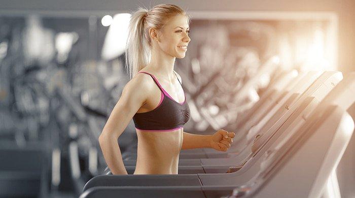Woman burning kilojoules on the treadmill