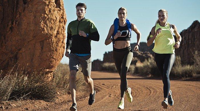 three people on a trail run