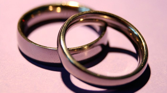 wedding rings that have been taken off after one of the partners decided to cheat