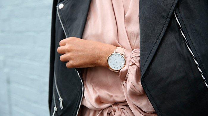 A woman wearing a wristwatch