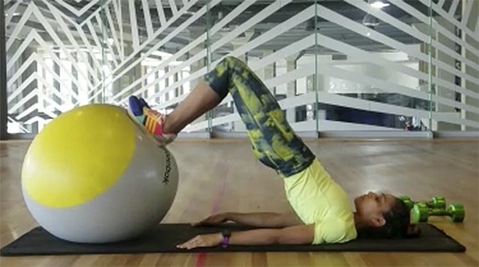 Raeesa performing strength moves with a ball