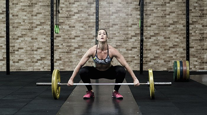 A woman who makes use of her daily strength-training habits to boost her fitness levels