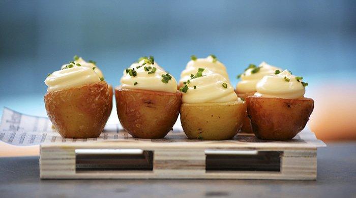 stuffed potatoes on a board