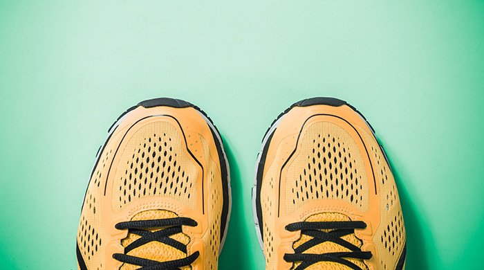 sneakers on a green background for a bedroom workout