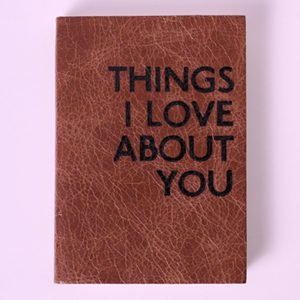 A book that says things I love about you to represent the traits guys find hot