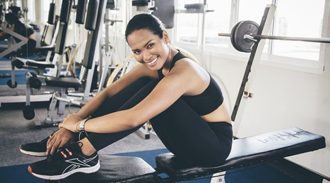 A woman doing a gym workout to get fitter