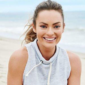 Emily Skye on the beach for her Women's Health cover shoot