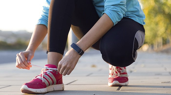 Woman tying her laces before running