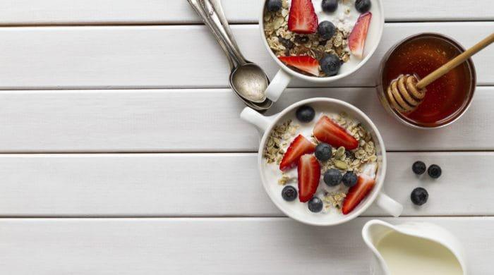 Vegan family breakfast spread of vegan cereal and fruits