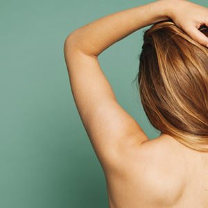 A woman showing her back to symbolise someone with bacne