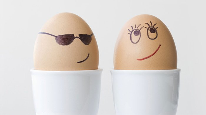 two boiled eggs with face to represent why women go for bad men
