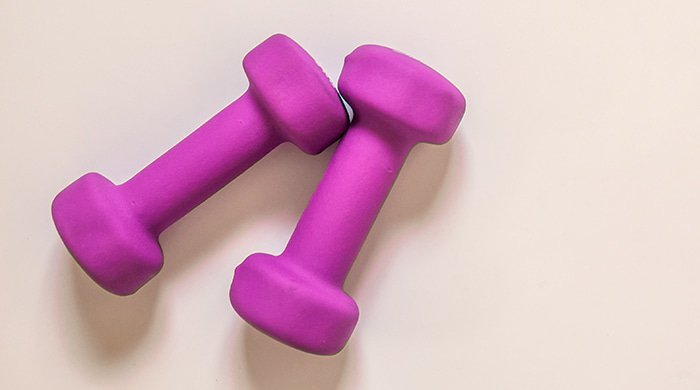 purple dumbbells which you need for strength training