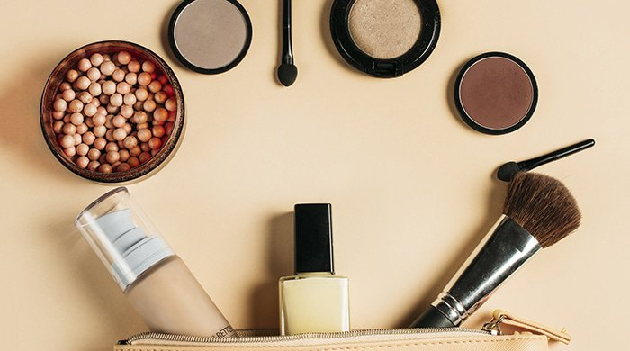 Make-up flat lay of products that will help cover acne
