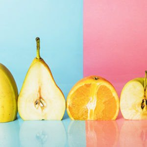 fruits which are cellulite-busting superfoods on a blue and pink background