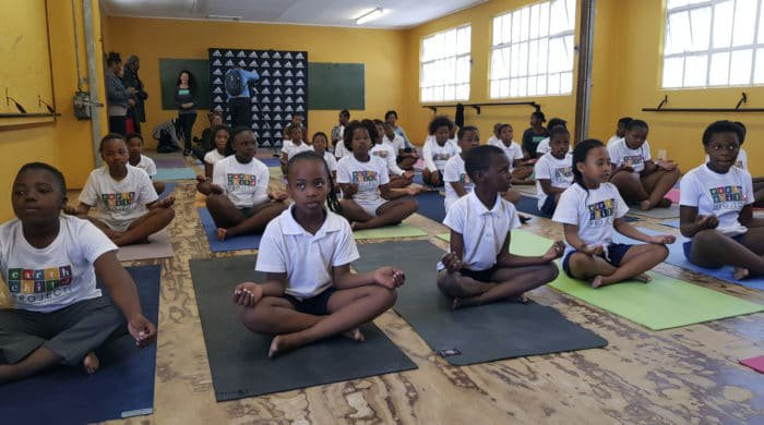 These kids doing yoga is the most adorable thing you'll see today