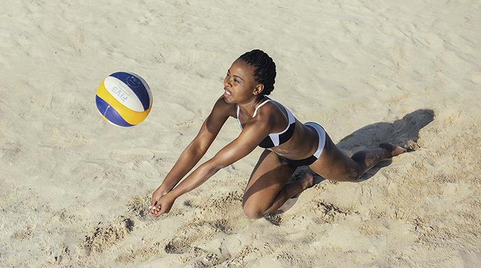 A woman doing a beach volleyball workout to get a tight tush