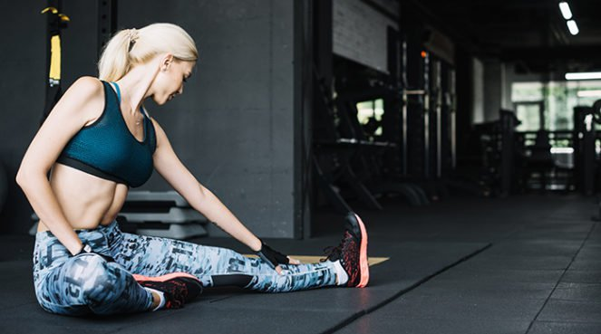 A woman stretching after doing leg workouts