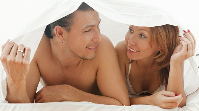 A couple trying a stressful sex position