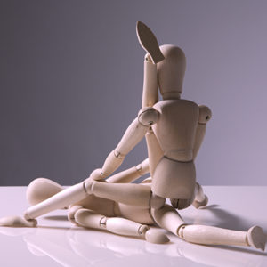 two wooden dolls engaged in crazy sex positions