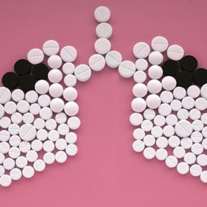 Pills shaped like lungs on a pink background to represent a story about lung cancer