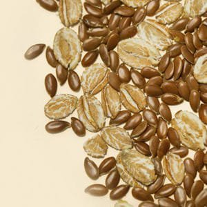 Flax seeds and oat flakes, close up view
