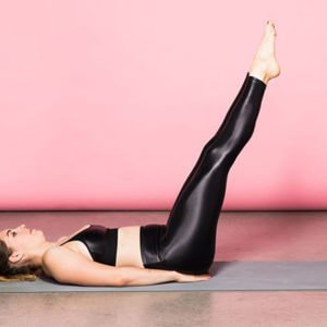 a woman doing lying leg raises