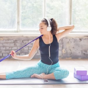 A woman using a resistance band to stretch