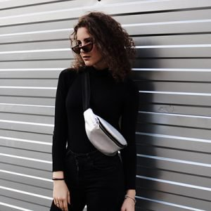 a woman wearing a moonbag