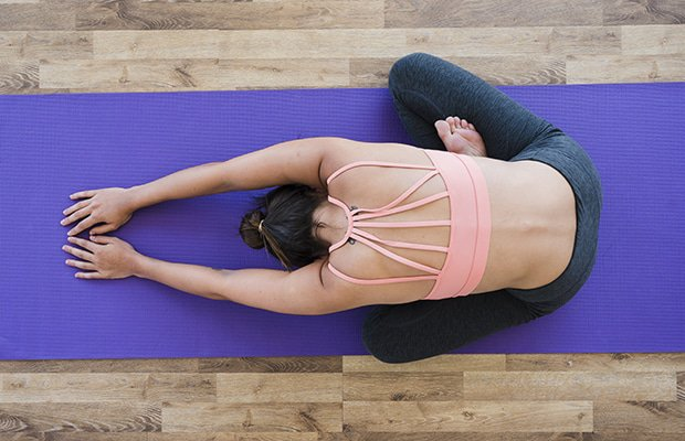 These Are The Stretches You Should Be Doing Before Race Day