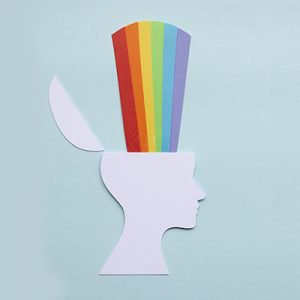 Paper head with rainbows to represent mental health