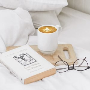 morning routine styled image on bed