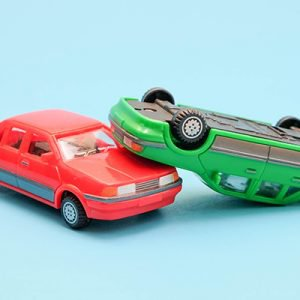 Close-Up Of Toy Cars Against Blue Background For A Story About The Demerit System