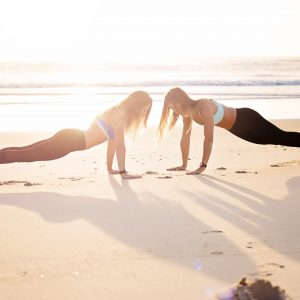 two women being active on the beach