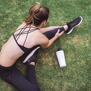 a woman stretching doing active recovery